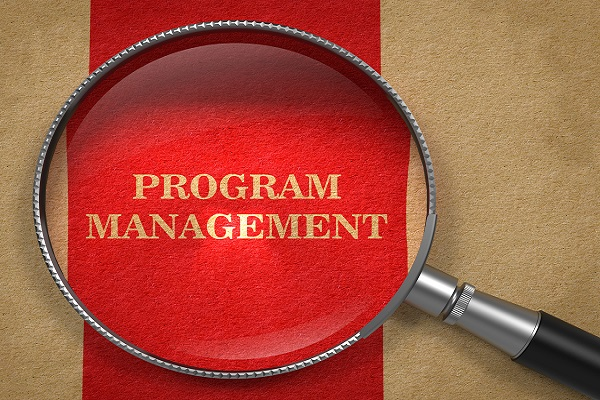 Program Management Concept. Magnifying Glass on Old Paper with Red Vertical Line Background.